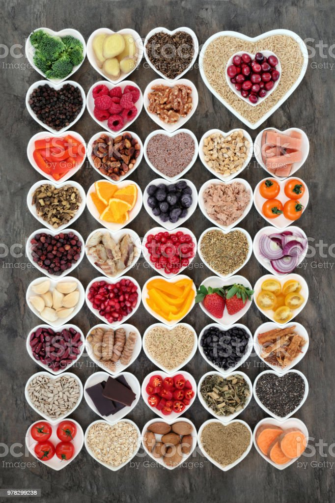 Super food for a healthy heart concept with health foods of fish,...