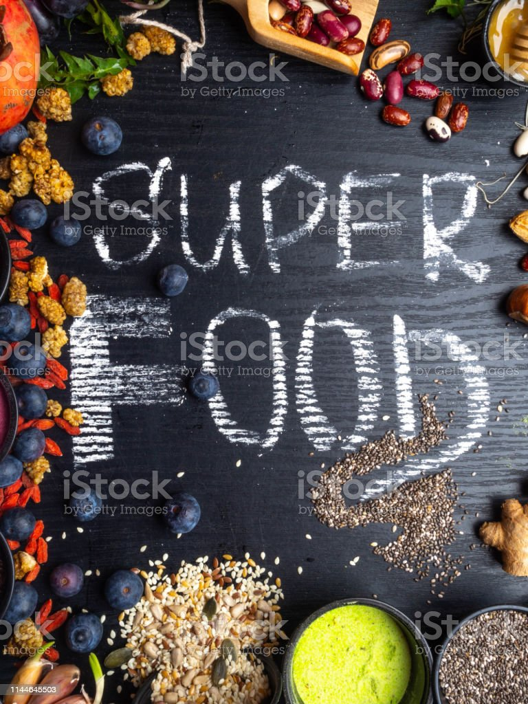 Super food selection. Various super foods and healthy foods in wooden...