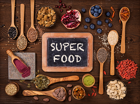 istock Super foods in spoons and bowls 516043292
