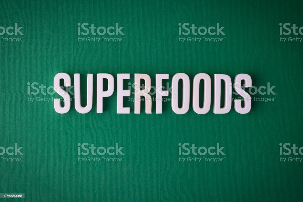 Super foods lettering sign stock photo