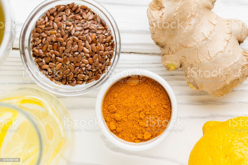 Super foods, turmeric, ginger, lemon, flax seeds, green tea stock photo
