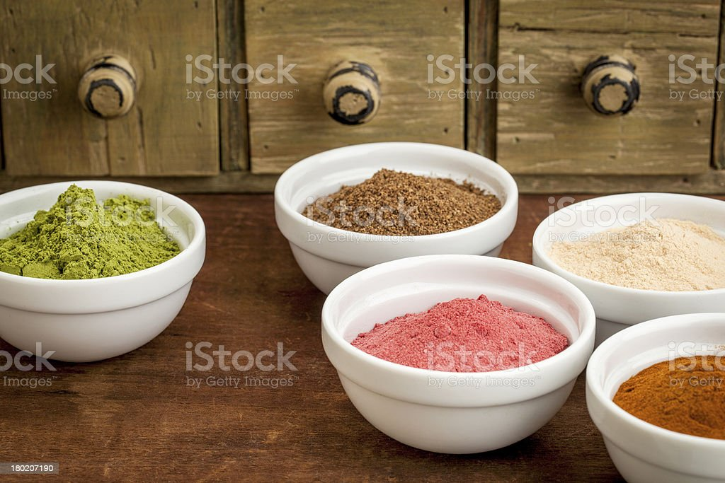 super fruit and leaf powders stock photo