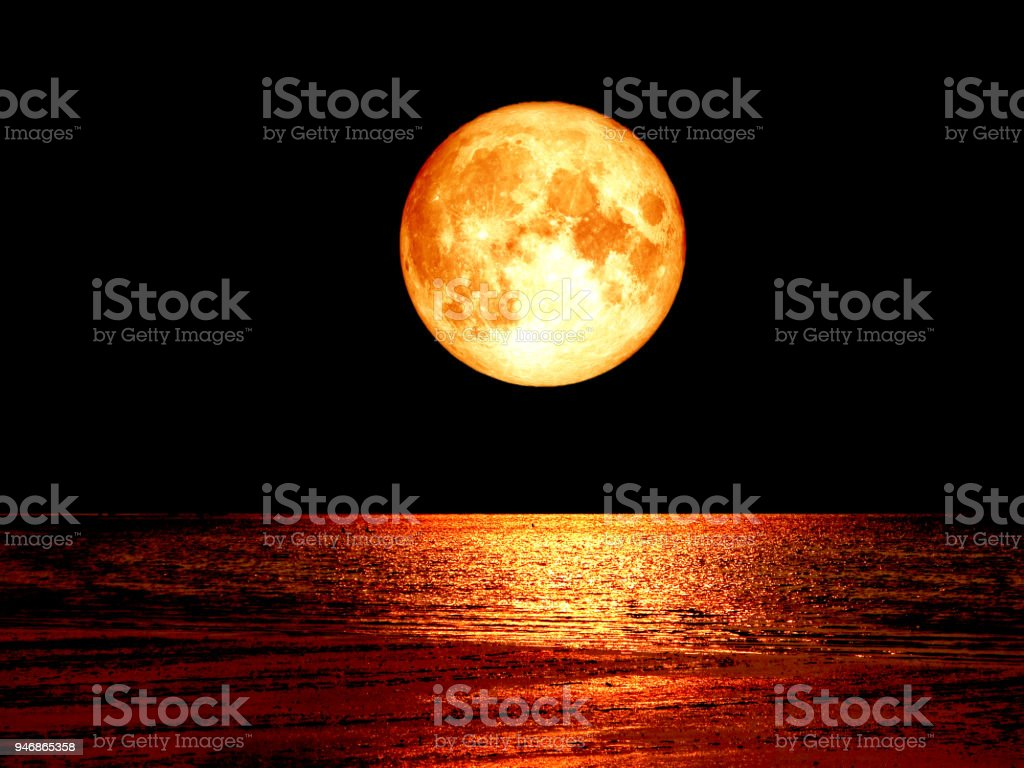 super full blood moon on sea and night sky backgroud stock photo