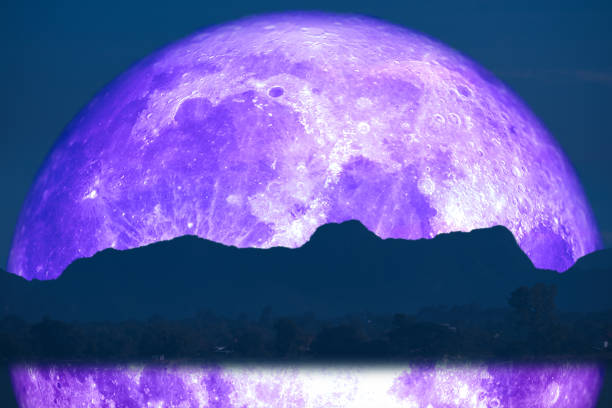 super full fish moon back reflection on river and mountain on night sky stock photo