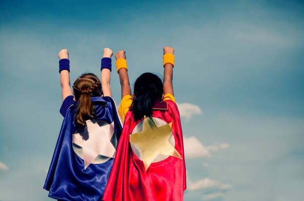 super girl duo - partnership stock photos and pictures