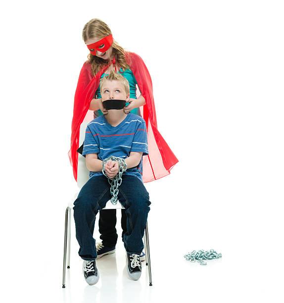 Super girl rescues little brothe - foto de stock