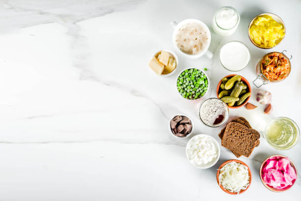 Super Healthy Probiotic Fermented Food Sources Super Healthy Probiotic Fermented Food Sources, drinks, ingredients, on white marble background copy space top view fermenting stock pictures, royalty-free photos & images