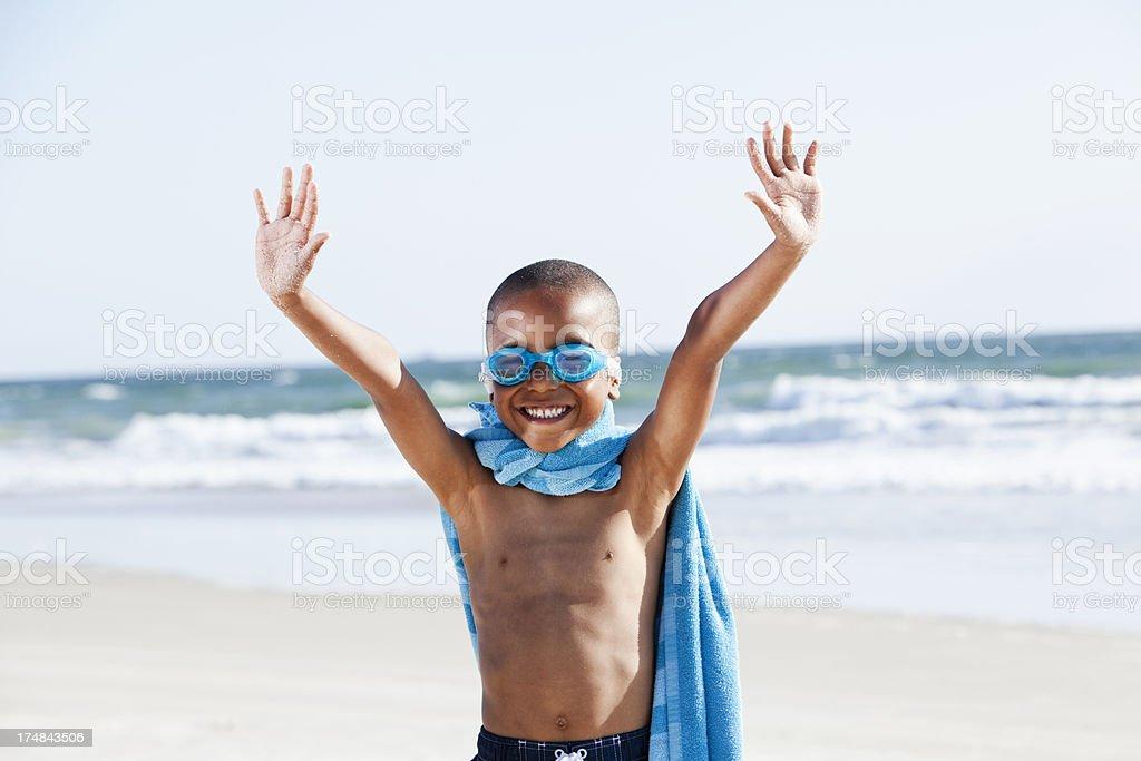 Super hero at the beach stock photo