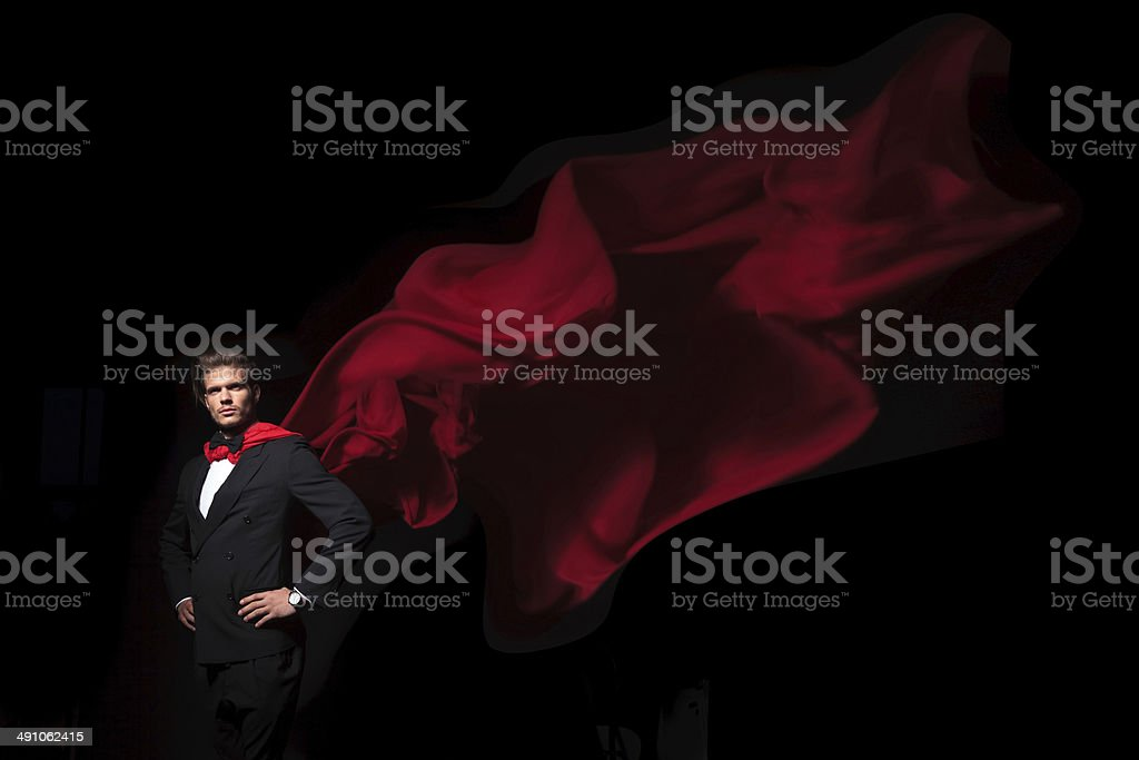 super hero business man in red cape stock photo