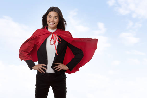 super-helden arbeiten geschäftsfrau - damen umhänge stock-fotos und bilder