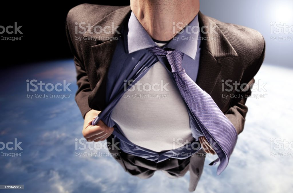 Super Hero Pulling Open Shirt Above Earth stock photo