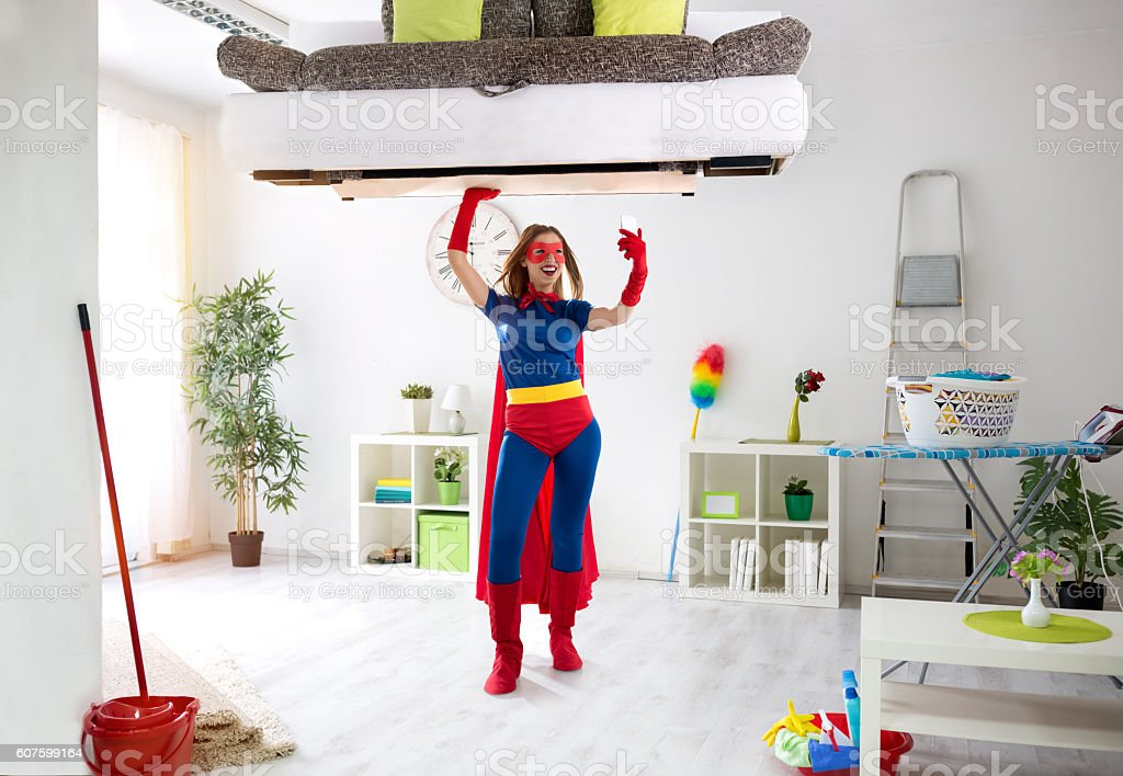 Super hero woman taking selfie and keep the bed stock photo