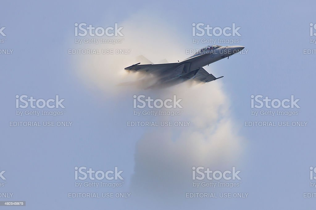 F-18 Super Hornet travels subsonic speed with visible Vapor Cone stock photo