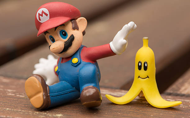 Super Mario Slipping Issaquah, WA, USA - March 28, 2015: Super Mario toys humorously posed nintendo stock pictures, royalty-free photos & images