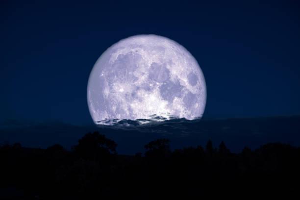 super milk moon back on silhouette mountain on night sky stock photo