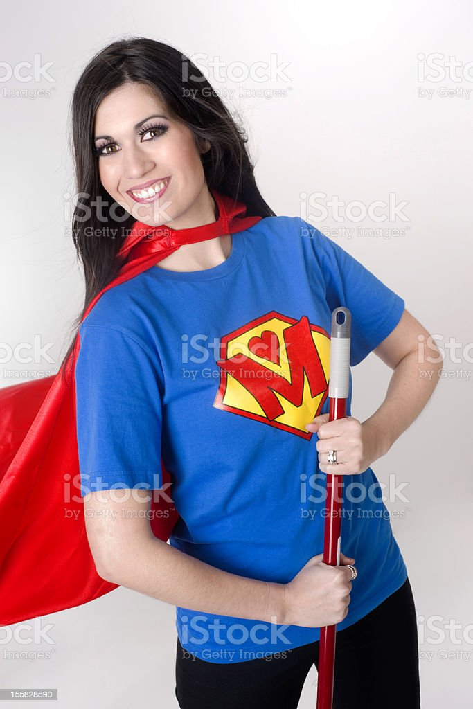 Super Mom with Crest and Cape Sweeps the Floor stock photo