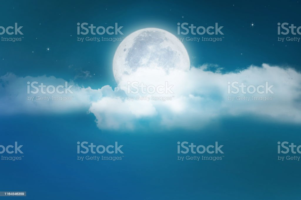 Super moon. a bright full moon and stars above the seascapes at...