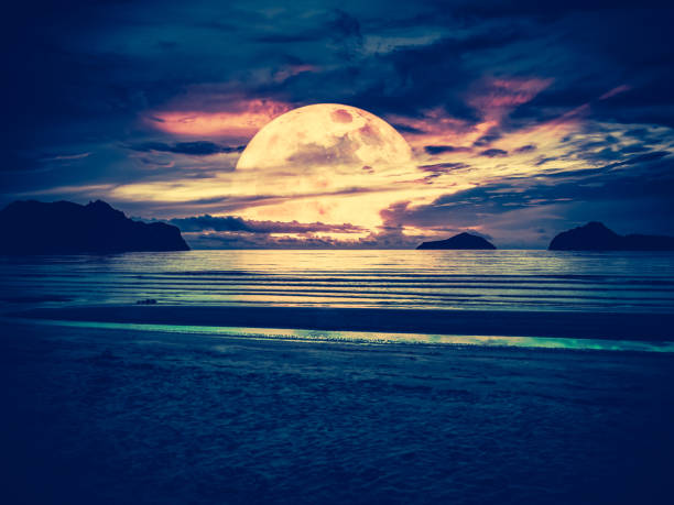 Super moon. Colorful sky with bright full moon over seascape. Serenity nature background stock photo