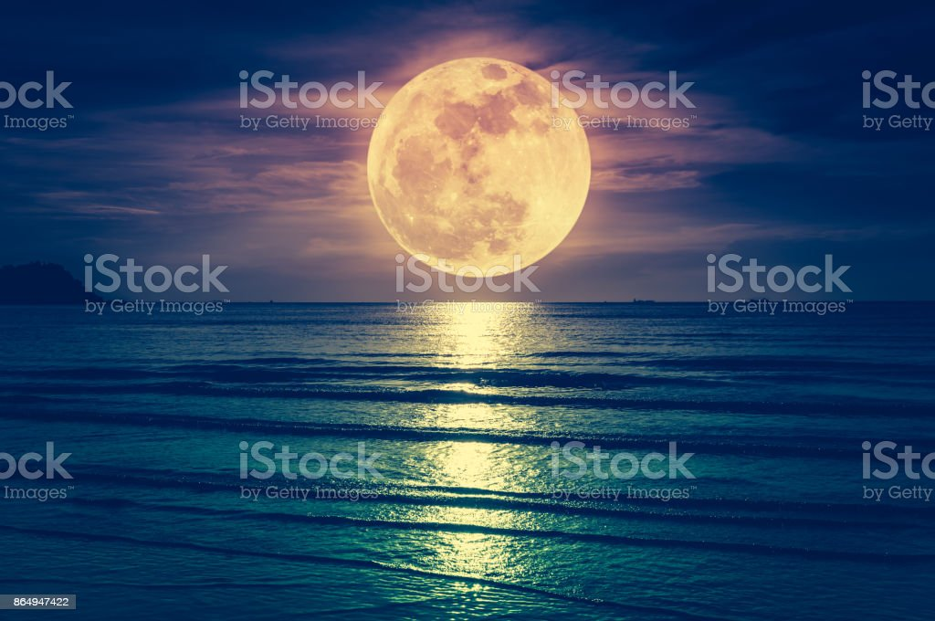 Super moon. Colorful sky with cloud and bright full moon over seascape. stock photo