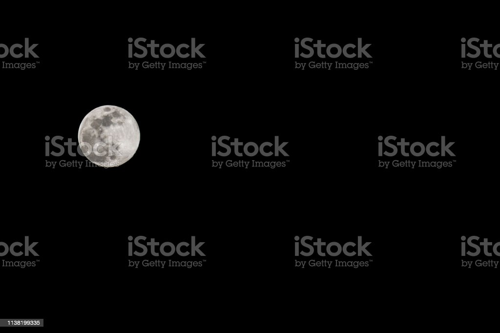 Isolated super moon in black night sky