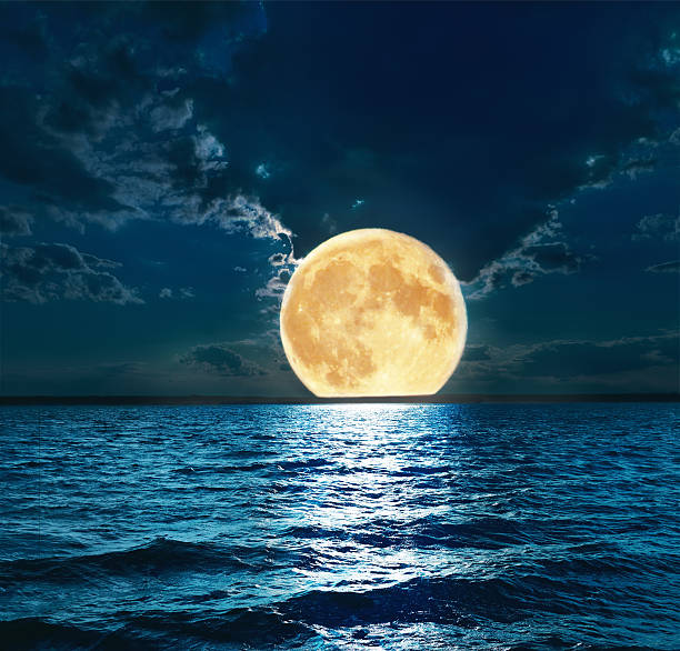 super moon over water - romantic moon stock photos and pictures