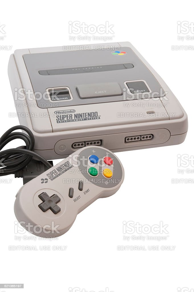 Super Nintendo Console and Controller stock photo