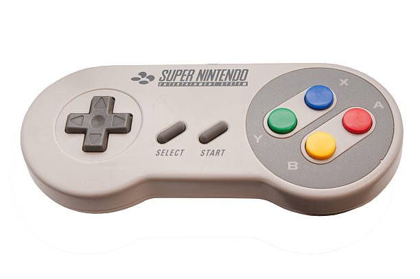 Super Nintendo Controller Adelaide, Australia - October 27, 2014: A studio shot of a Super nintendo video game controller. A popular 16-bit entertainment system sold worldwide during the 1990's. nintendo stock pictures, royalty-free photos & images
