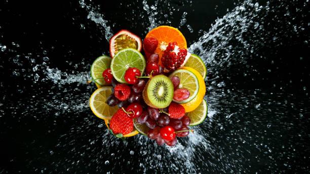 Super Slow Motion Shot of Fresh Fruits with Splashing Water stock photo