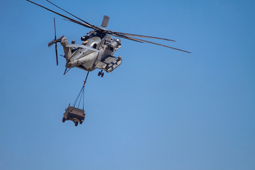 CH-53E Super Stallion (Sikorsky) Helicopter carrying military humvee