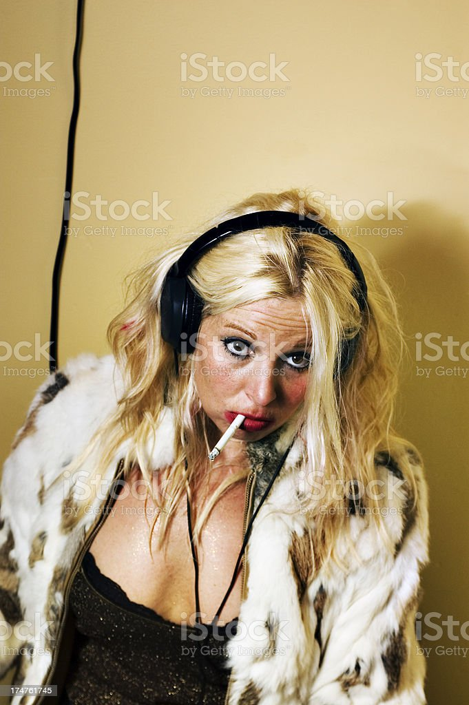 Trashed out woman with fur and cigarette.THIS