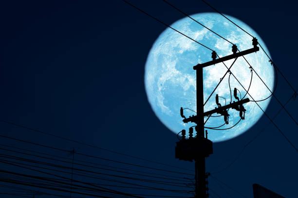 Super sturgeon blue moon back silhouette power electric line on night sky stock photo