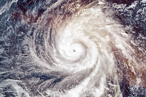 istock Super Typhoon Yutu, strongest storm on Earth in 2018. Satellite view. Elements of this image furnished by NASA. 1059301550