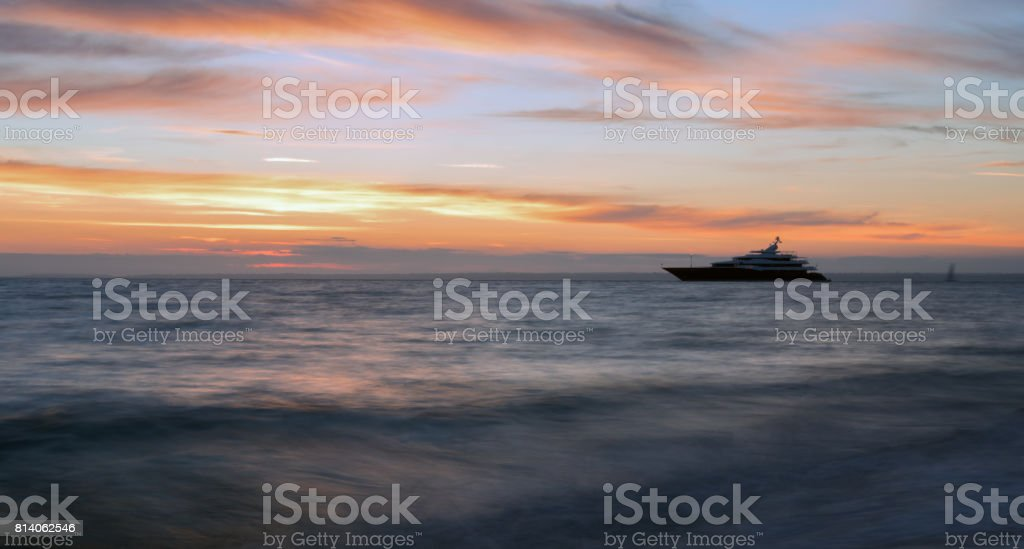 Super Yacht just off the Isle of Wight at sunset stock photo