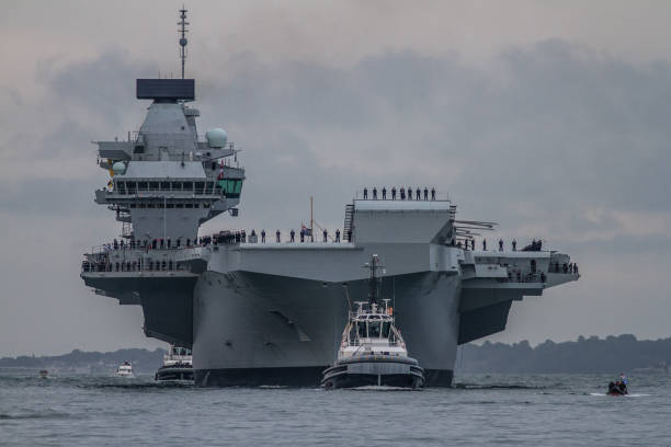 supercarrier or warship - uk military stock photos and pictures