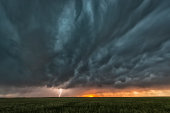 A supercell thunderstorm rolls across the Great Plains of the USA in mid summer.