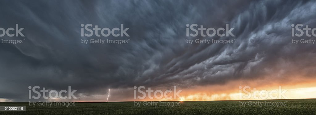 Supercell thunderstorm at sunset stock photo