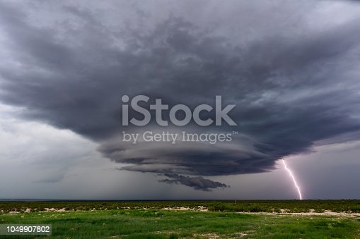 858837068istockphoto Supercell thunderstorm with lightning 1049907802