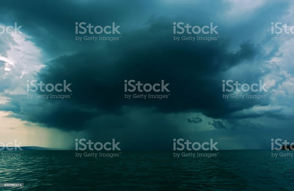 Supercell thunderstrom foorming above water surface stock photo