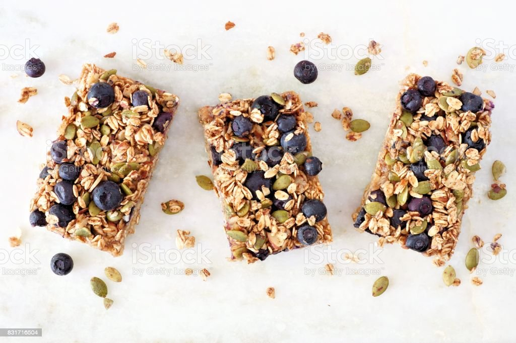 Superfood breakfast bars, above view on marble background stock photo