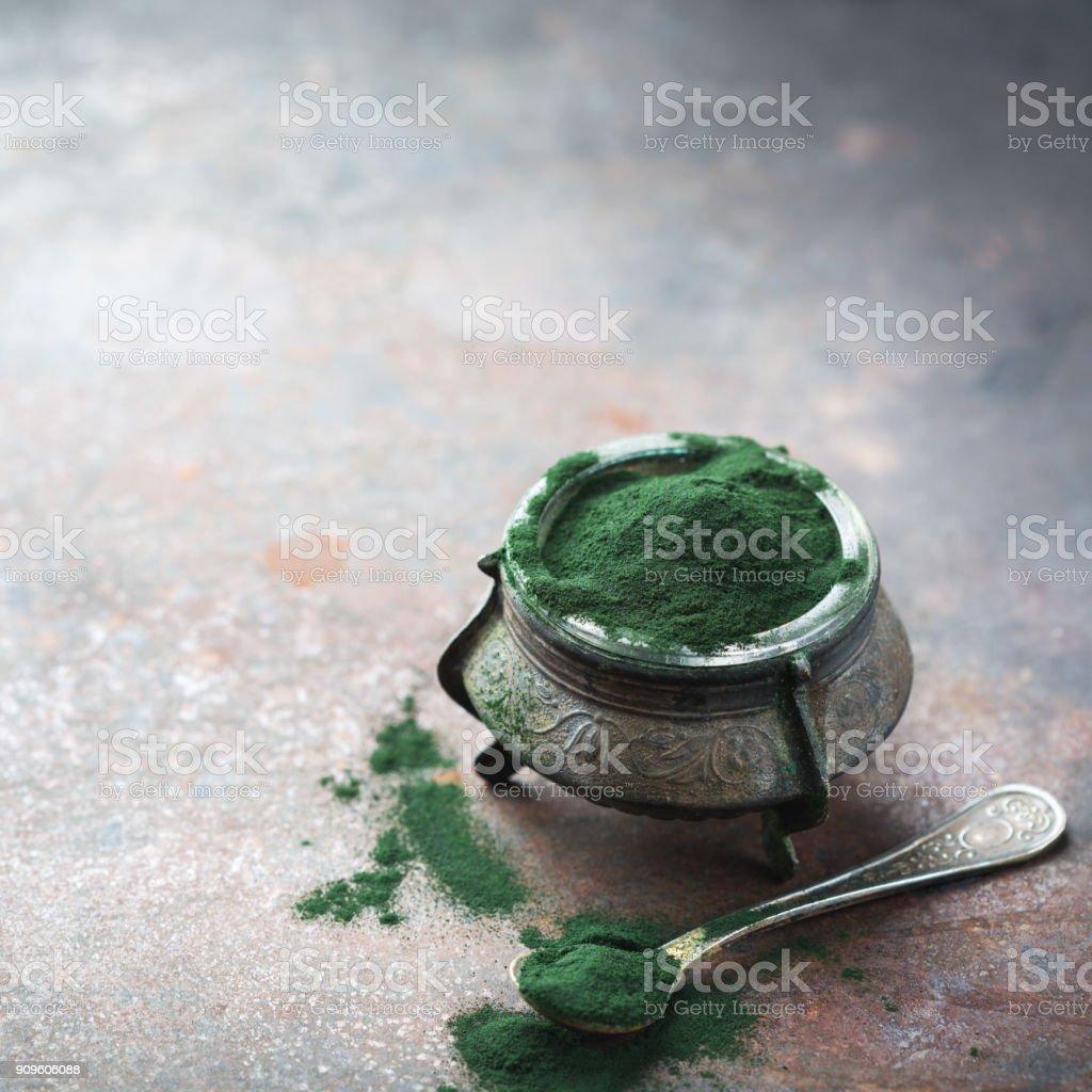 Superfood concept ground green spirulina algae powder stock photo
