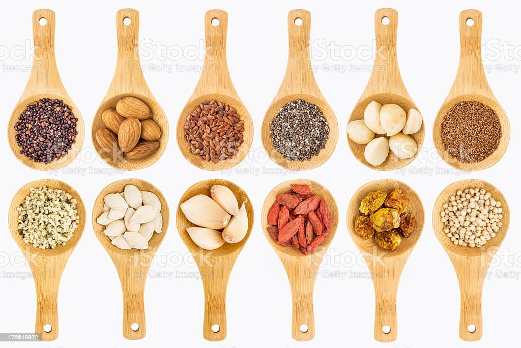 superfood grain, seed, berry and nuts abstract stock photo