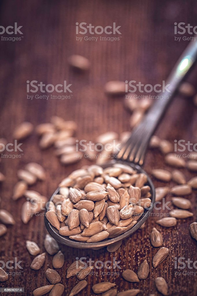 Superfood Sunflower Seeds on Wooden Background stock photo