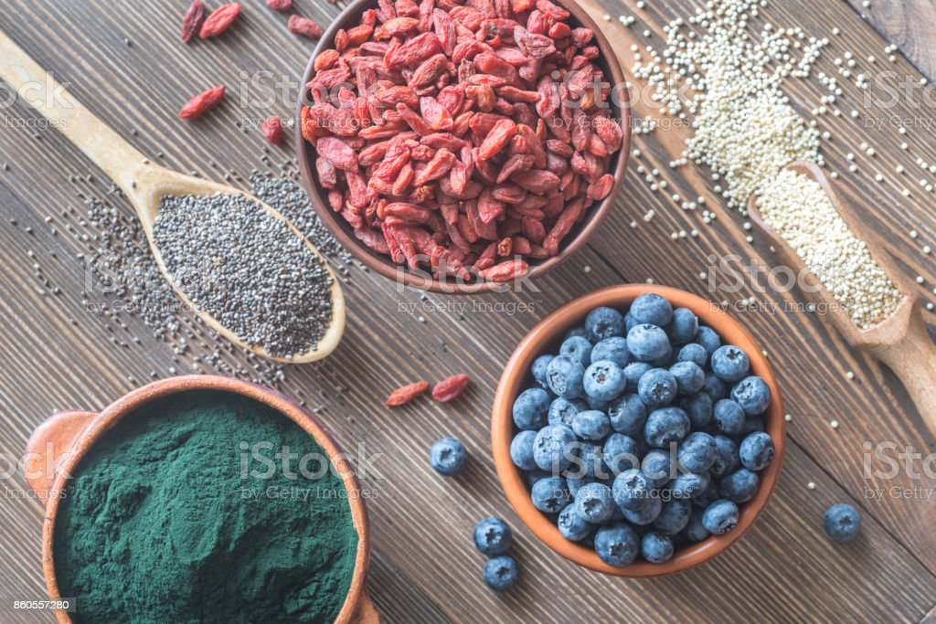 Superfoods on the wooden table stock photo