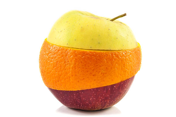superfruit - yellow, red apple and orange - genetic modification stock photos and pictures