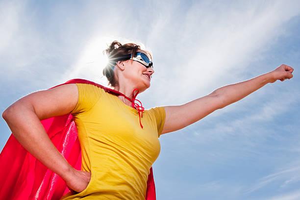 supergirl - damen umhänge stock-fotos und bilder