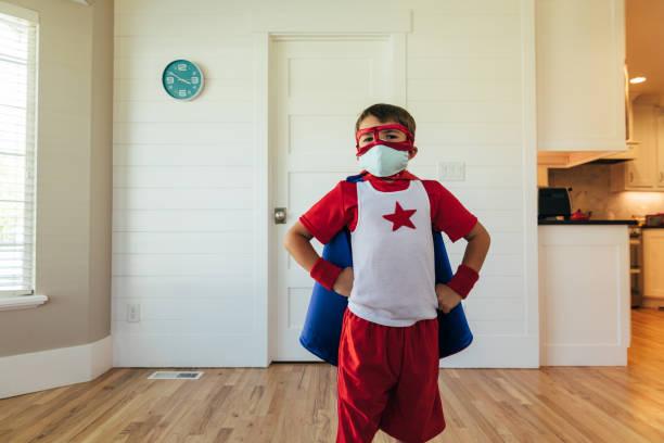 Superhero Boy with Two Masks