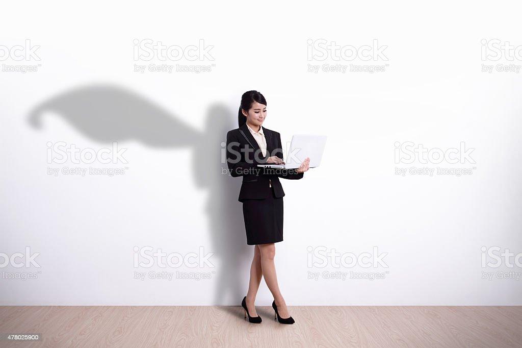 Superhero Business Woman with computer stock photo