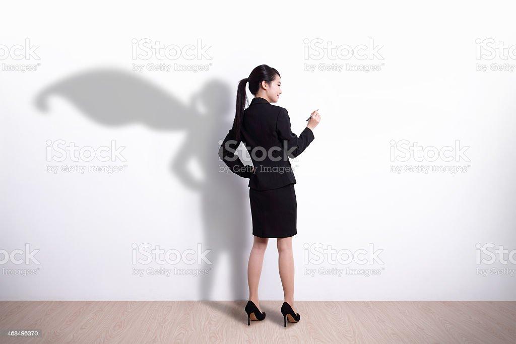Superhero business woman writing stock photo