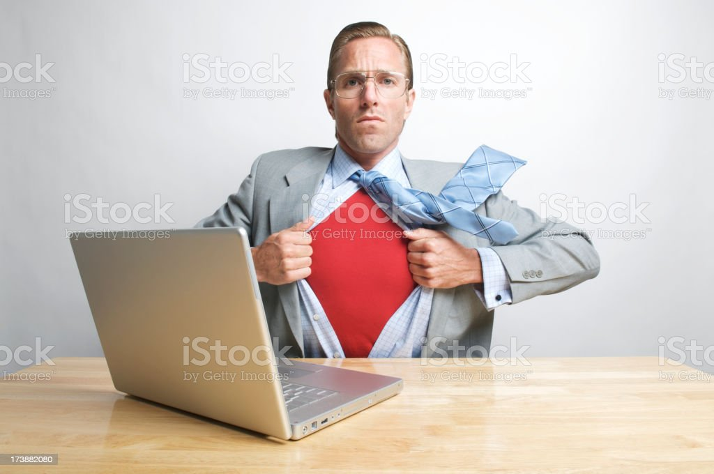 Superhero Businessman At Your Service Sitting at Desk royalty-free stock photo