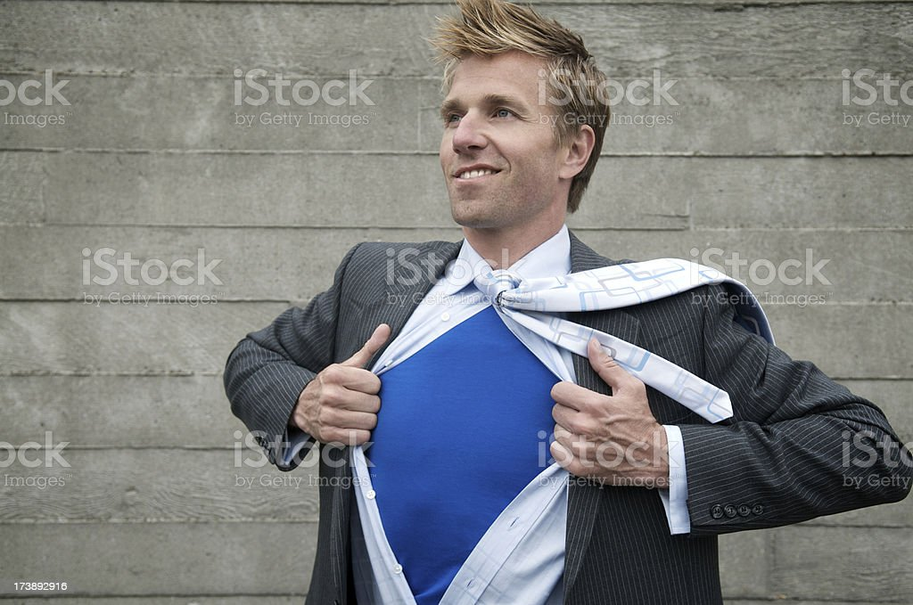 Superhero Businessman Gets Ready to Save Day Outdoors Gray Wall stock photo